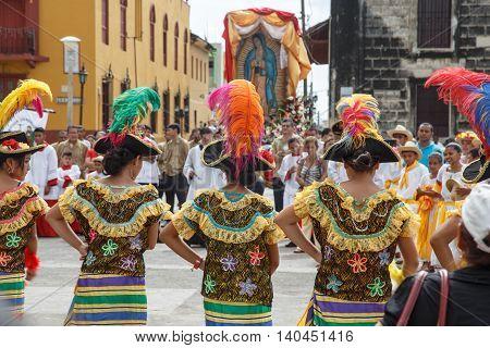 Leon Nicaragua - December 12 2015: Aborigen dancers in typical dress celebrating on the street