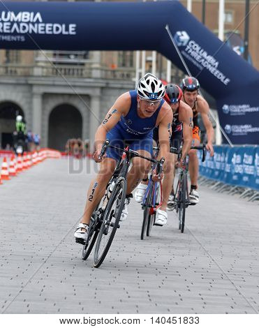 STOCKHOLM SWEDEN - JUL 02 2016: Group of male triathlete cyclists Kristian Blummenfelt (NOR) and competitors in the Men's ITU World Triathlon series event July 02 2016 in Stockholm Sweden