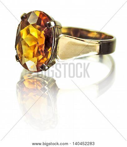 Golden citrine ring, precious gemstone. Isolated on white background.