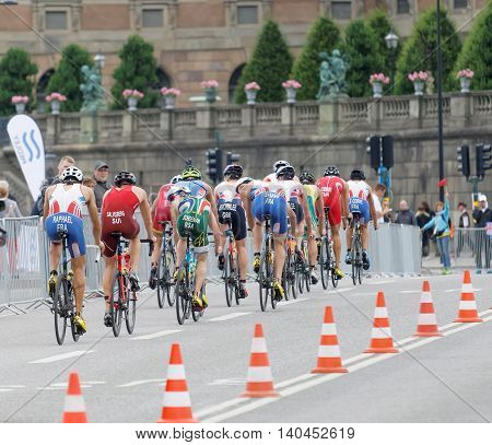STOCKHOLM SWEDEN - JUL 02 2016: Rear view of a large group of male triathlete cyclists in the Men's ITU World Triathlon series event July 02 2016 in Stockholm Sweden