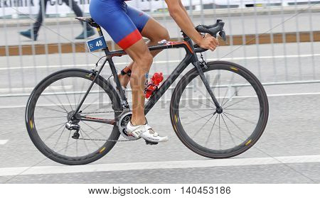 STOCKHOLM SWEDEN - JUL 02 2016: Side view of male triathlete cyclist without torso in the Men's ITU World Triathlon series event July 02 2016 in Stockholm Sweden