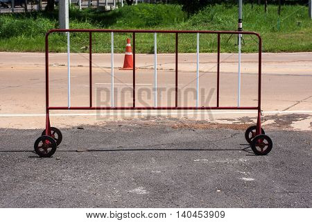 Steel wheel with red and white traffic barrier.
