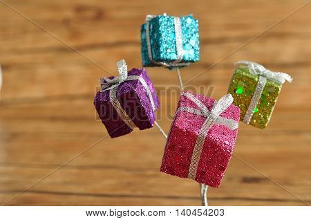 Little gifts in shinny wrapping for decorating a Christmas tree
