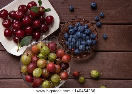 Berries On Wooden Background. Organic Food