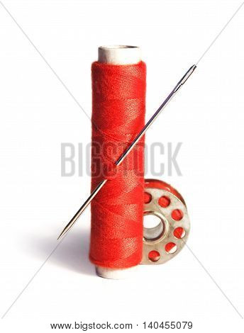 Sewing material, isolated on White background. Red thread.