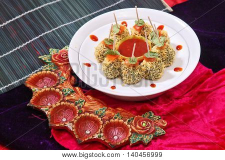 Special chinese meat ball on white plate on the table in restaurant