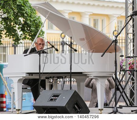 St. Petersburg, Russia - 23 July, Musician of the white piano, 23 July, 2016. Speech by David Goloschekin with his jazz group on the Arts Square in St. Petersburg.