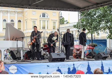 St. Petersburg, Russia - 23 July, Maestro in a bow on stage, 23 July, 2016. Speech by David Goloschekin with his jazz group on the Arts Square in St. Petersburg.