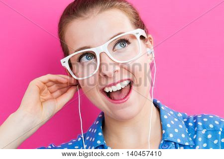 Happy Young Woman With Earbuds