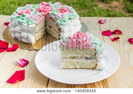piece of sponge cake  with curd cream  and banana on  background of cake