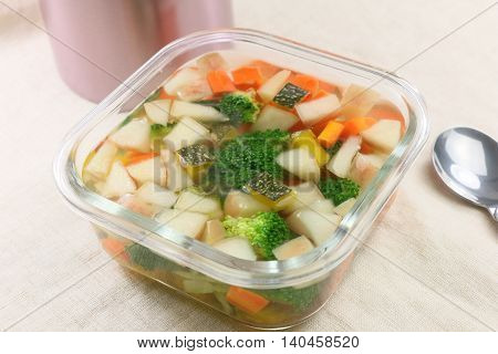 Vegetables soup with broccoli cucumber carrot and pumpkin in glass pot
