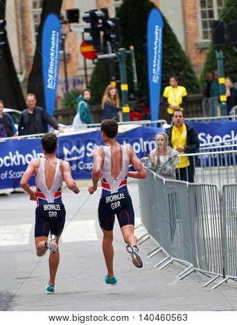STOCKHOLM - JUL 02 2016: Rear view of running triathletes Alistair and Jonathan Brownlee in the Men's ITU World Triathlon series event July 02 2016 in Stockholm Sweden