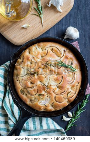 No knead roasted garlic and rosemary focaccia cake in black pan