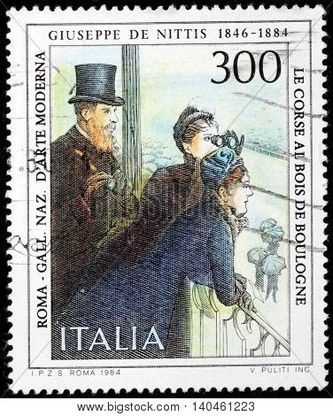 LUGA RUSSIA - JUNE 25 2016: A stamp printed by ITALY shows engraving after picture At Tribune during Race by Giuseppe De Nittis - Italian Salon art and Impressionism styles painter circa 1984.