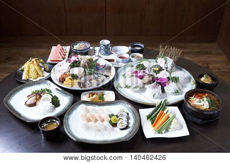 A traditional korean tray meal on wooden table