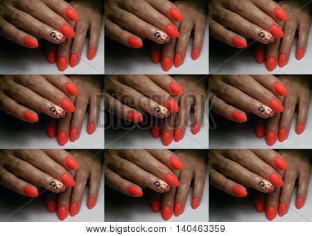 The repeating drawing. Pattern. The nail is covered with acryle. Beautiful manicure. On one nail the woman is drawn.