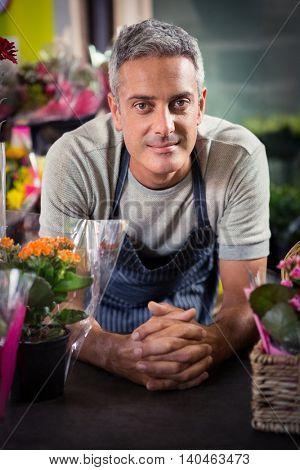 Portrait of happy male florist at his flower shop