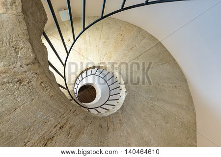 A spiral staircase taken from the bottom