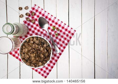 Cereal food and milk bottle and milk glass  on wooden sky blue table.Meal or breakfast hi-vitamin and calcium.1