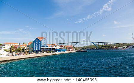 Colorful Curacao and Blue Bridge over harbor