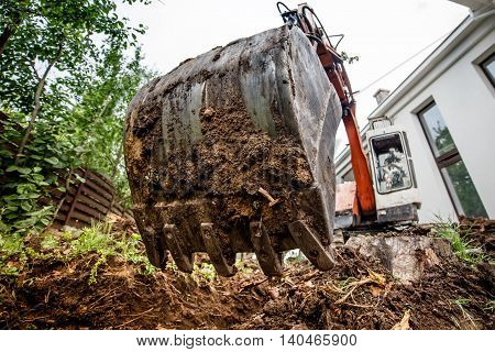 Industrial Heavy Duty Excavator Digging At Construction Site. Close-up Of Scoop And Metal Bucket. Wi