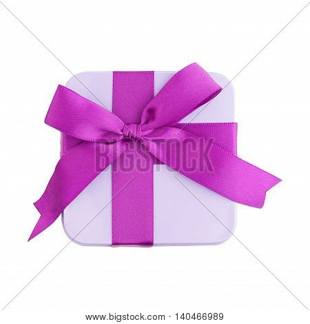 Metal gift box with purple bow isolated top view