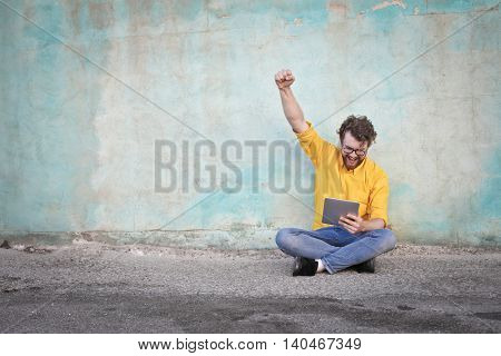 Satisfied man using technology