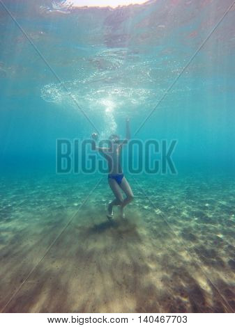 man dives into the sea