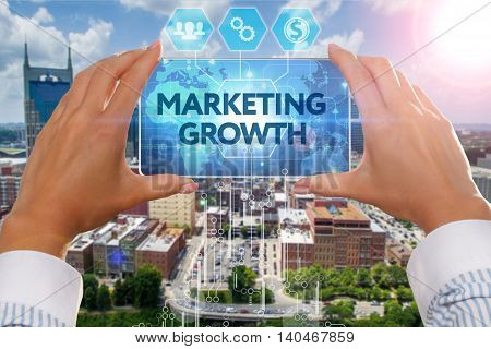 The Girl Looks At A Virtual Screen Of Your Smartphone And See The Inscription : Marketing Growth