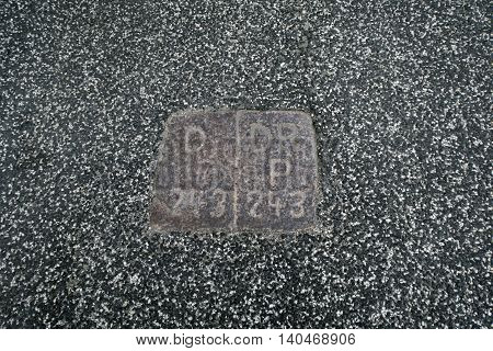 Border stones in the road by Rudboel Denmark. Left is Germany and right is Denmark. Stone number 243.