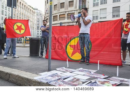 MILAN ITALY - JULY 27 2016: Kurdish activists protest against Turkish president Erdogan and his policy and ask freedom for PKK leader Ocalan.
