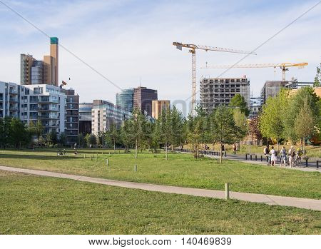 BERLIN GERMANY - JULY 22 2016: Gleisdreieck Park with Potsdamer Platz in the background Berlin Germany