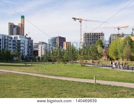 BERLIN GERMANY - JULY 22 2016: Gleisdreieck Park with Potsdamer Platz in the background Berlin Germany