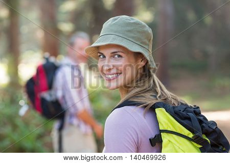 Portrait of smiling hiker hiking in forest