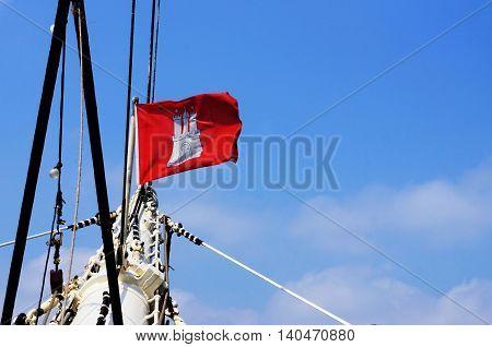 Hamburg flag on a sailing ship in summer