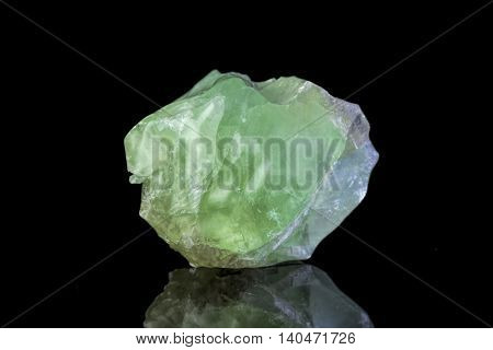 Sample of a beautiful natural green Calcite specimen over black background