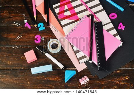 a set of school supplies on wooden background , school and creativity