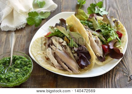 Tacos with chicken and vegetable salad with green sauce