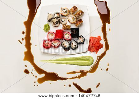 art composition of assorted rolls, ginger, wasabi and soy sauce