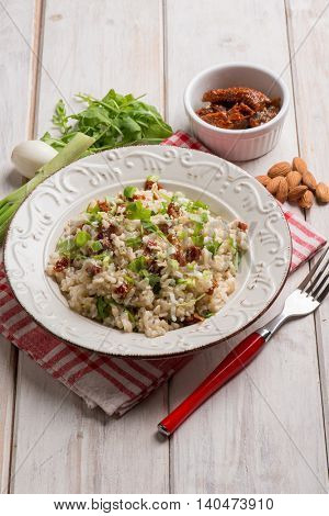 risotto with arugula dried tomatoes and almond