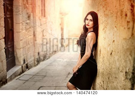 Sensual dark-haired woman with black dress