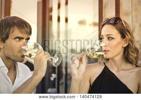 Couple drinking a glass of wine