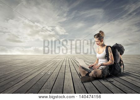 Backpacker sitting on the ground
