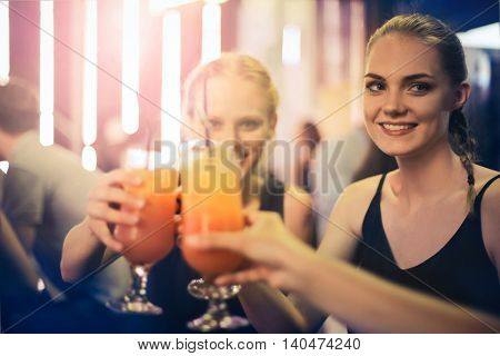 Happy girls drinking a cocktail