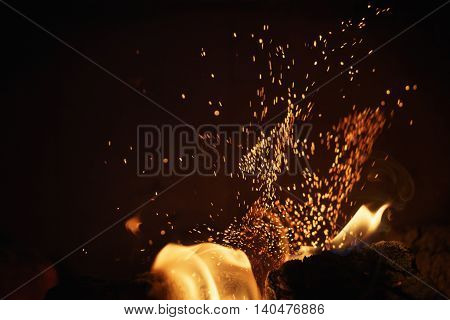 close up of charcoal burning in fireplace, abstract photo