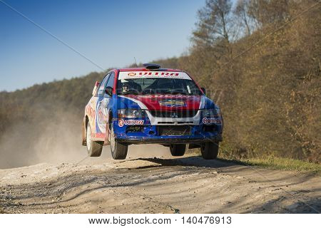 Lviv Ukraine - November 1 2015: Boris Ganga's Mitsubishi Lancer Evo IX (No. 2) competes at the annual Rally Galicia