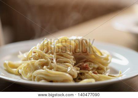 fresh homemade spaghetti carbonara with smoked bacon, shallow focus