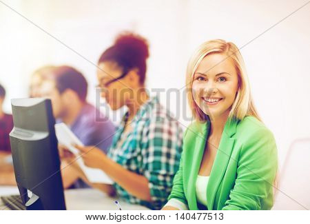 education concept - student girl with computer studying at school