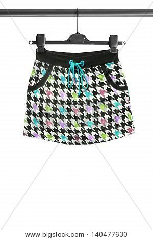 Colorful mini skirt on clothes rack isolated over white