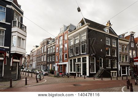 Amsterdam Netherlands - July 03 2016: Traditional Dutch houses on a deserted Kirk street in Amsterdam